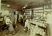 Vintage Cabinet Photo Interior Store American Flags Pottery Cactus Antique