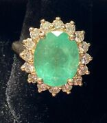 Certified 14 Carat Gold Oval Natural Emerald And Diamond Cluster Ring