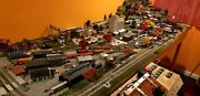 Large N Scale Gauge Train Set Layout With Lighting Structures And Trains