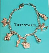 And Co Sterling Silver Dog Cat Teddy Clown Horse Toy Multi Charm Bracelet
