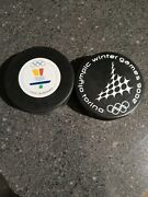 2006 And 2010 Official Olympic Hockey Puck Lot 2.