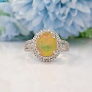 Natural Opal And Diamond 18ct White Gold Halo By David Jerome