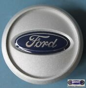 And03905-and03909 Ford Used Center Cap Embedded Blue Ford Logo 2-5/8 Dia. 3587
