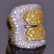 Vibrant Yellow And White Sapphire Buckle Ring In Yellow And White Gold