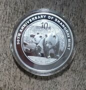 China 2010 Silver 1 Oz Panda Coin With Added Words - 90th Ann. Of Shanghai Mint