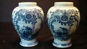 A Pair Of Dutch Delft Vases With House And Flower Motif