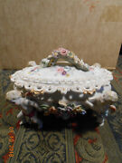 VINTAGE ARDALT LENWILE PORCELAIN BOWL AND COVER SUPPORTED WITH FOUR WINGED PUTTI