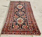 An Antique Runner Rug With Flowers