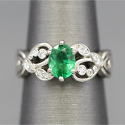 Emerald And Diamond Engagement Ring In Palladium With Vines And Celtic Knot