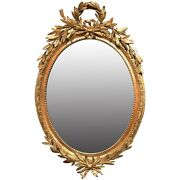 French Gilt Foliate Decorated Oval Wall Mirror Early 19th Century