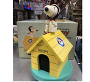 Peanuts Charlie Brownand039s Lovable Snoopy Red Baron Wooden Musical Doghouse