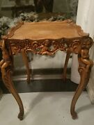 Antique Heavily Carved Cherub Wood Table