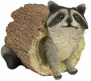 Statue Of Raccoon In A Log 7.5 High Made Of Resin
