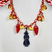 Figural Carved Bakelite Dutch Girl And Clogs Bakelite Charms Necklace On Celluloid