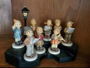 Hummel Figurines And Wooden Stand