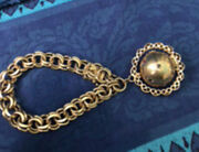 Vintage 61 G 14kt Gold Charm Bracelet With Photo Orb Charm Saphires And Rubies
