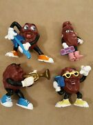 Four Vintage California Raisin Figures With Guitar Trumpet And 2 Boomboxes/radios