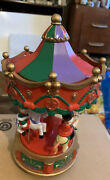 Vintage Spinning Carousel W Santa And Toys Riding