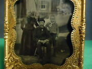 1/6 Tintype Of Man, Woman And Young Boy With Houses In Background In Frame
