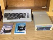 Vintage Commodore 64 Computer Keyboard And 1541 Floppy Disc Drive With Manuals