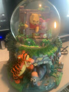 Winnie The Pooh Playing Poohsticks Musical Snowglobe