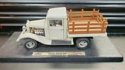 Road Signature 1934 Ford Pick Up. 118 Scale. White. Stakebed. 271627.