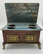 Vintage Tin Toy Stove With Embossed Doors Damaged Foot