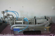 Two Nozzles Pneumatic Liquid Filling Machine 30-300ml For Water Juiceshampoo