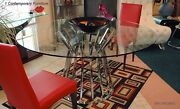Olivia Dining Table With 59 Round Clear Glass Top And Polished Stainless Steel