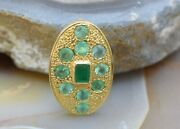 18k Yellow Gold Emerald Pendant 10 Round Faceted Stones And 1 Emerald Cut Center