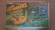 Tyco Super Cliff Hangers With Nite Glow Electric Slot Car Track Set