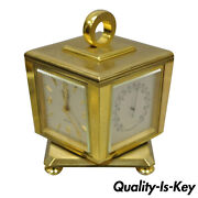 And Co. Eight Day Brass Four Caster Revolving Small Desk Clock