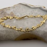 14k Yellow Gold Cupid Bracelet With 16 Bright Cut Cast Figures Circa 1990