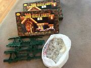 Two Boxes Of Icicle Lights With Roof Clips And Storage Organizers