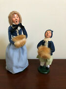 1986 Byers Choice Carolers Lot Of 2, 1 Women And 1 Girl With Fur Muffs With Bags
