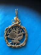 Pendant Hand Carved From A Foreign Coin Fish Swimming In Coral In The Ocean