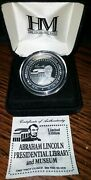 One Troy Ounce .999 Fine Silver Coin Abraham Lincoln Library - The Highland Mint