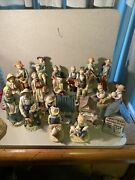 Around 20 Homco And Other Brands Of Ceramic People Figurines And Buildings