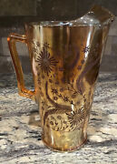 """Jeannette Glass Marigold Carnival Brown Cosmos Glass Pitcher 9 3/4""""t Ice Lip Ex"""