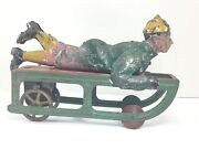 Early 1900's Dayton Boy On Sled Pressed Steel Friction Toy, 9 1/8 Working