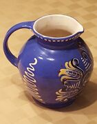 Blue Pottery Pitcher with Slip and Sgraffito Decoration