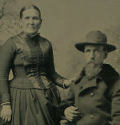 Older Couple Woman Touching Mans Shoulder. Man In Hat And Coat. Tinted Tintype.