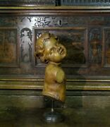 A Large Carved Walnut Figure Of A Child On Stand. France C.1720