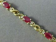 Estate 4.80ct Diamond And Aaa Ruby 14kt Yellow Gold Oval Infinity Bracelet 16386