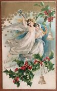 Beautiful Christmas Angels Aloft With Trumpet And Lyre Holly Embossed Postcard