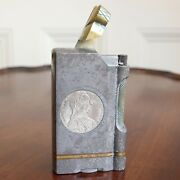 A Wwii Steel And Brass Trench Art Table Lighter With Silver Thaler Coins Inset.