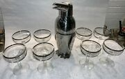An Art Deco Penguin Stainless Cocktail Martini Shaker And 8 Silver Band Glasses