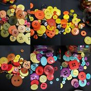 Six Glass Jars Filled With Large And Small Craft Sewing Buttons