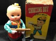 Vintage Toy. Shooting Boy Clock Work Boxed Made In China Ms576
