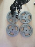 4 - 25lb Standard 1 Inch Hole Weight Plates. Solid Cast Iron